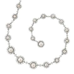 Platinum, Natural Pearl and Diamond Necklace   The graduated necklace set continuously with 25 natural button-shaped and round pearls approximately 8.1 to 4.3 mm., and one freshwater natural pearl approximately 7.6 mm., encircled and spaced by 277 old European, old-mine and single-cut diamonds approximately 12.00 cts., circa 1905, approximately 29 dwts. Length 17 inches.