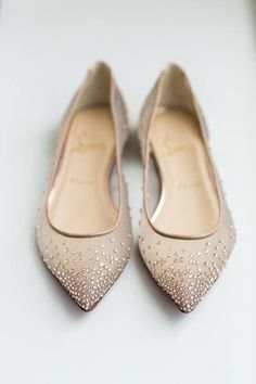 Flats are a new statement show for brides and bridesmaids. Can't stand heels? Can't stand in heels? Everyone should be comfortable on their wedding day and these Christian Louboutin jewel encrusted champagne color flats seem like a step in the right direction