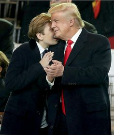 Barron Trump with his father President Donald Trump