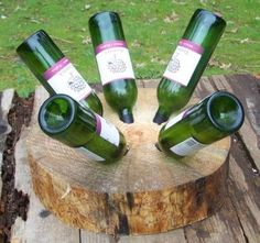 tree stump wine rack - Get in touch with nature while you drink with the tree stump wine rack. This wine rack is made out of an actual tree stump and holds up to four bot...
