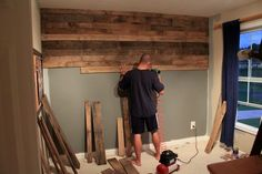 Gorgeous pallet wood wall with detailed instructions on how they did it. From just a girl blog. #diy #repurpose #home decor.