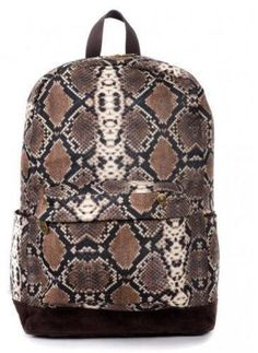 This Mojo Brown Serpentine Backpack will even get the colded blooded creatures warming up to you. This pack's printed Polyester Snake skin design is just great for any reptile lover. Dont miss out on this truly unique item while supplies last!