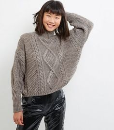"""Combine comfort and style this season with this cropped jumper. Pair with coated trousers and boots to complement.- Funnel neckline- Chunky cable knit texture- Simple long sleeves- Cropped hem- Soft finish- Casual fit that is true to size- Grace is 5'10.5""""/179cm and wears UK 10/EU 38/US 6*Premium: A quality collection carefully crafted with unique detail, intricate embellishment and super-soft knitted fabrics.*"""