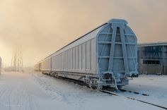 Railroad car in wintery fog.