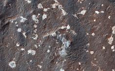 Light-Toned Deposits in Vinogradov Crater