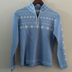Neve 100% New Wool BEAUTIFUL Vintage Sweater Beautiful light blue wool zip neck nordic sweater in excellent condition. Beautiful pattern, ornate zipper pull, and very well constructed collar seams. Excellent and beautiful layer. Tag says medium, but fits like a small.  ***Will consider reasonable offers***  Neve describes their sweaters as warm and breathable, able to be used for layering (and then straight to dinner from the slopes☺). These awesome sweaters, depending on the style, often…
