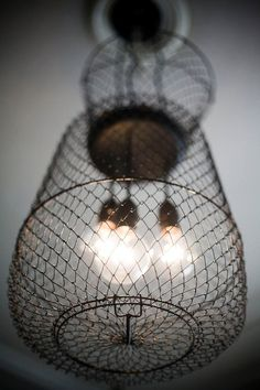 Use the old commercial whisks to make lighting fixture, sorta like this.