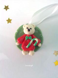 Polymer clay teddy bear christmas tree decoration - Ourson en porcelaine froide décoration de Noël http://www.alittlemarket.com/accessoires-de-maison/fr_decoration_de_noel_ourson_rouge_et_blanc_en_porcelaine_froide_fimo_a_froid_a_suspendre_-16164727.html