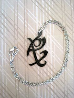Fearless Rune Necklace by makersgonnamake on Etsy, $10.00