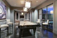 3435 Meadow Lake Ln, Houston, TX: Photo View from entry gallery of living room and gorgeous sun room.Billiard's table included in sell, fabric covered ceiling , floor to ceiling hide away closets, Caged Paper shade lantern in polished nickel and pocket doors for privacy.