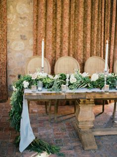 Rustic meets elegant garland topped table decor: http://www.stylemepretty.com/2015/12/08/scottsdale-wedding-at-silverleaf-golf-club/ | Photography: Erich McVey - http://erichmcvey.com/