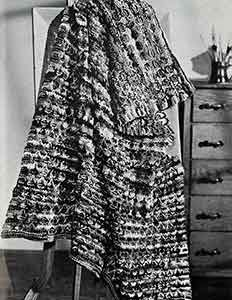 Quick Knit afghan pattern originally published in Decorator Afghans, Book 142. #knitpatterns #afghanpatterns