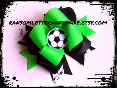 Acid Green Soccer Bow Lime and Black by ransomletterhandmade Acid Green and Black Soccer Boutique Bow. Includes a handmade embroidered felt soccer ball in the center. $11.00
