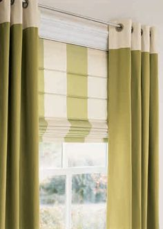 I like this look, might prefer skootching the Roman to meet the drapery rod but sometimes that's not possible. This is the next best option .. coodinating drapes and shades