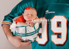 Love this! I will have to have this picture one day. :) except with the giants instead of the dolphins
