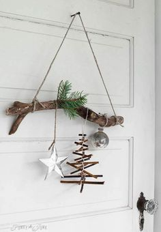 rustic twig Christmas tree ornament on a branch - - Love decorating with nature? Make this rustic twig Christmas tree ornament on a branch in minutes! Very easy, and a great kid craft! Other twig garlands too. Twig Christmas Tree, Christmas Decorations For The Home, Noel Christmas, Diy Christmas Ornaments, Rustic Christmas, All Things Christmas, Christmas Crafts, Twig Tree, Simple Christmas