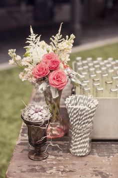 Lovely vintage theme... cheerful florals, bottled drinks and striped straws!
