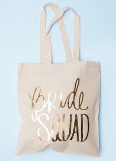 Gift your Bridesmaids the Bride Squad Bash Bag, available in gold, pink, and purple!