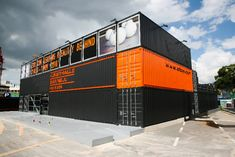 The Platoon Kunsthalle Gwangju is made up of dark grey and orange cargo containers and houses emerging art and subculture exhibitions as well as an event hall and bar.