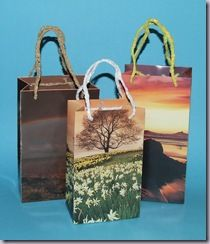 Recycle old calendar pages into gift bags.