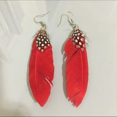 Feather earrings! Red feathers with smaller polka dotted feathers Jewelry Earrings