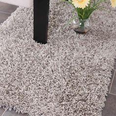 our foyer rug - Safavieh Machine-Made Shag Rug in siver.  SG851S-24