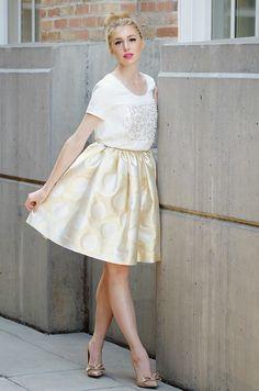 Gold polka dot skirt, bow heels and animated top