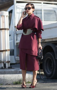 Miraslava Duma killing it in another all over maroon outfit at Paris Fashion Week. This is feeling very marsala to us.