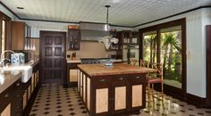 Stunning attention to tdetail. Custom hand painted walls and deep wood pair to make this elegant kitchen.