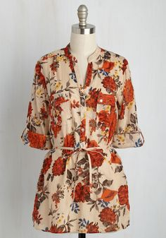 What's on the menu when you're wearing this bucolic floral blouse? Farm-fresh produce, of course! Button the bodice, roll up the tab sleeves, and cinch the string sash of this cotton top, for its tan, red, and dark grey hues will look rustically chic as you cook your bounty!