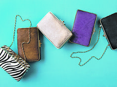 Gift guide: The Kingston Clutch is the perfect size (6 by 3 3/4 inches) to go from day through night and comes with a metal chain so you can go hands-free at a party. Choose from calf hair solid colors or zebra print or an embossed leather. Prices from $165 to $185, J. McLaughlin, 7623 Bellona Ave., Ruxton. 410-825-5485; jmclaughlin.com.