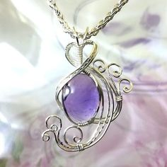 This purple amethyst womans pendant necklace jewelry is wire wrapped in silver and entirely handmade by me and includes free shipping. Please note that the item pictured is a sample only, yours will be the same color, size and shape but there will be some natural variations. This is my