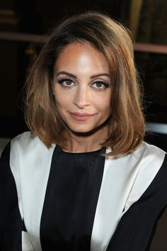 Eventually, it was chocolate brown and one length. | The Hair Evolution Of Nicole Richie