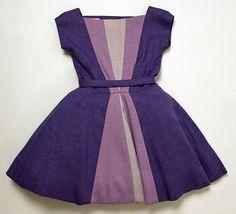 Little girl's purple cotton dress (front), by Mr. Luis Estévez, American, 1958.