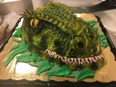 Buttercream dinosaur cake made with a small egg shaped cake and buttercream