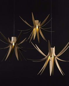 Delicate petals from handcrafted strips of birch plywood. Iris Pendant by Mac Master.