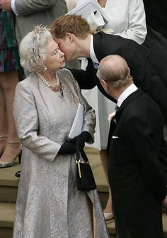 Harry giving a kiss to his Granny, at his cousin Peter's wedding.