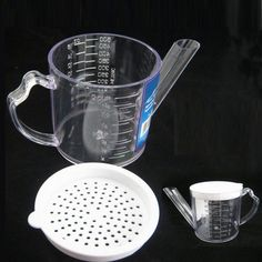Gravy Oil Fat Separator Measuring 2 Cups w/ Strainer Seperator Measurer Kitchen by ATB. $7.49. New 2 Cup Gravy Fat Measuring Separator W/ Straining Cover Skimmer Reduce Calories !! This clear plastic gravy separator separates fat from gravy, soup, stock, and sauces Reduce fat & calories Holds 2 cups/500 ML/16 oz So easy to use - no more spooning the fat off the top Ships next day from Our wearhouse