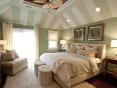 Islander Ceiling Fan. Muted colors and light fabrics are staples in a coastal-style room. Striped Ceiling. Designer Adam Zollinger.