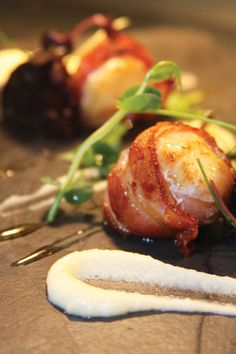 Scallop pops wrapped in smoky bacon at Eat Drink Bristol Fashion.    This makes me wish that I liked seafood.
