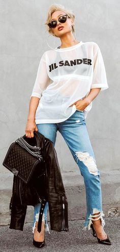 #spring #outfits  woman wearing mesh t-shirt and distressed blue denim pants holding jacket. Pic by @fashion.and.sugar