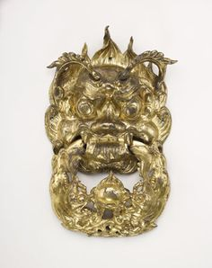 Door handle in the form of a dragon mask and a ring | 618-907 | Tang dynasty | Bronze with gilding | China | Gift of Charles Lang Freer | Freer Gallery of Art | F1915.105