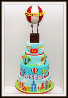 "Growing up, up, up and away cake by Bellina's (hot air balloon is a 6 inch styro ball covered in fondant. top tier was airbrushed to get that ""rays effect"")"