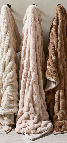 Faux Fur Ruched Throws | Our best-selling cozy throw is created with incredibly silky fibers and ruched for a cascading ripple effect. A longer, ultra-plush pile and substantial weight set it apart, while velvet binding gives it a clean, luxe appeal. #giftsforwomen #giftideas #christmasgifts #christmasideas