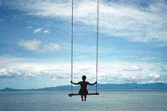 swing in the sky above the sea