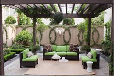 Love the pergola and the pop of color on the outdoor furniture.