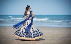 Blue Bridal Lehenga: A dark blue Bridal lehenga highlighted by the twirling bride capture by www.anoop.photography