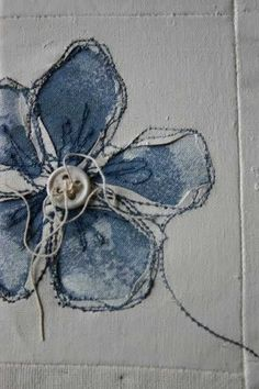 . white card cut out with denim or dyed fabric underneath....for blue poppies?