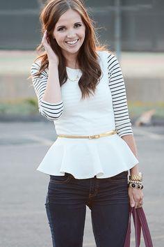 People should start wearing more long sleeved peplum tops because this is actually super adorable.