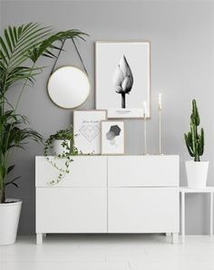 A clear tons entrance welcome you in. #white #whitedecoration #interiors #interiordesign #entrance #decor #Whitedecor #mirror #pictures #frame #plants #plantsdecor #grey #greywall #minimalistic #minimalist #minimalistdecor #scandinavian #scandinaviandecor